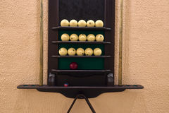 Universal rack of billiard balls and cues. Royalty Free Stock Photography