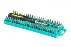 Universal screwdriver with set of bits in a box Stock Image
