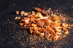 Universal spice mix for shish kebab and fish close-up in macro on dark background stock photo