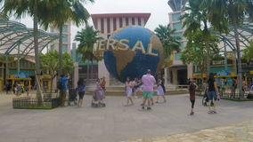 Universal Studio Park, Singapore - 3 November 2016: Timelapse of Rotating Globe infront of the Entrance stock footage
