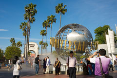 Universal Studios Hollywood. Los Angeles, California, USA - May 21st 2011: Universal Studios Hollywood globe and theme park entrance with visitors enjoying Royalty Free Stock Images