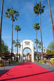 Universal Studios Hollywood. Los Angeles, California, USA - May 21st 2011: Universal Studios Hollywood theme park entrance with a losng red carpet leading to the Royalty Free Stock Photos