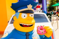 Universal Studios Hollywood Park, Los Angeles, USA. LOS ANGELES, USA - SEP 27, 2015: Police Chief Wiggum at The SImpsons area of the Universal Studios Hollywood Stock Images