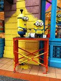 Universal Studios Singapore Minions Despicable Me as Painters Painting Wall. Minions painting the wall yellow at Universal Studios Royalty Free Stock Photography