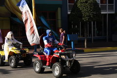 Universal Studios Super Heroes. ORLANDO - NOV 15: Taken in Orlando, Florida, November 15, 2010. Captain America and the Super Heroes ride four wheelers in stock photo