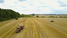 Tractor Loading Bales Of Hay stock video footage