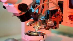Universal wire bonder microelectronic equipment in work. In the stock video