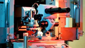 Universal wire bonder microelectronic equipment in work. In the laboratory stock video footage