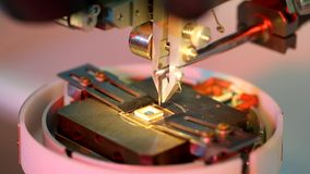 Universal wire bonder microelectronic equipment in work. In the laboratory stock video