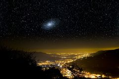The Universe above city lights. Stock Photography
