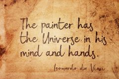 Universe in mind Leonardo. The painter has the Universe in his mind and hands - ancient Italian artist Leonardo da Vinci quote printed on vintage grunge paper stock photo