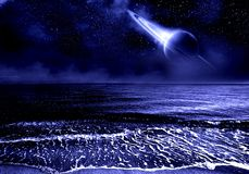 Universe and sea. Starry sky and the rise of the planet Saturn from across the ocean fantasy planet stock images