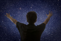 Universe. Starry sky and silhouette of man Stock Image