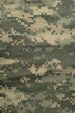 Universell kamouflagemodell, enhetlig digital camo för arméstrid, closeup för USA militär ACU-makro, detaljerat stort reva-stopp  Arkivbilder