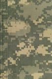 Universell kamouflagemodell, enhetlig digital camo för arméstrid, dubbletttrådsöm, closeup för USA militär ACU-makro, detaljerat  Royaltyfri Fotografi