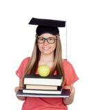 Universidad con el sombrero de la graduación y muchos libros Imagen de archivo libre de regalías