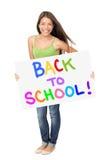 Universitaire studentenholding terug naar schoolteken Stock Fotografie