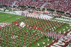 Universitet av Alabama miljon dollarmusikband- och fotbollslagenterance arkivfoton