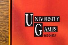 Universitet Spela Korporation logo Arkivbild