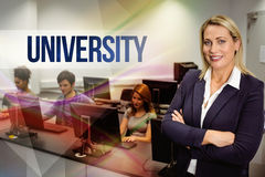 University against computer teacher smiling at camera with arms crossed Royalty Free Stock Images