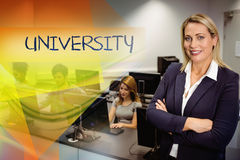 University against computer teacher smiling at camera with arms crossed Royalty Free Stock Photo