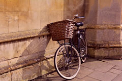 University bicycle near the wall in sunset Royalty Free Stock Images