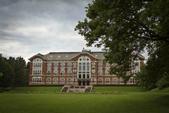 University Building. Classic old and venerable university building with dramatic skyes and light. This is the Norwegian University of Life Sciences in Ã…s ( stock image