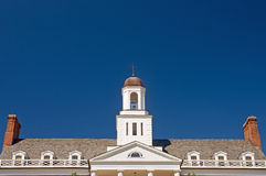 University building facade. A view of the roof, steeple, and front facade of a university campus building on a bright and sunny morning.  University of Maryland Royalty Free Stock Image