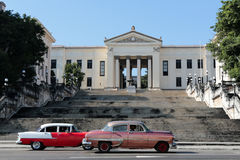 University building at Havana. A view to the university at Havana, Cuba with two old cuban cars Stock Photos