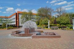 University  building in Lodz - Campus. Modern University  building in Lodz and square with a nice fountain Stock Image
