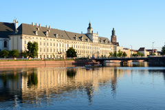 University building at Odra river in Wroclaw, Poland Royalty Free Stock Photos