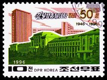 University building, Ryongnam Pyongyang, 50th anniversary of Kim Il Sung University, Pyongyang serie, circa. MOSCOW, RUSSIA - FEBRUARY 21, 2019: A stamp printed royalty free stock photos