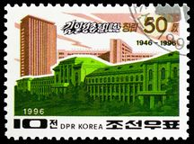 University building, Ryongnam (Pyongyang), 50th anniversary of Kim Il Sung University, Pyongyang serie, circa 1996. MOSCOW, RUSSIA - FEBRUARY 21, 2019: A stamp royalty free stock images