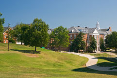 University campus. A view across a grassy hillside to buildings and walkways on the campus of a large US university. University of Maryland stock photo
