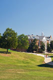 University campus. A view across a grassy hillside to buildings and walkways on the campus of a large US university.  University of Maryland Royalty Free Stock Photography