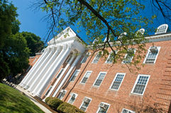 University campus building. A view of the front side to a university campus building with trees on a bright and sunny morning. University of Maryland stock photos