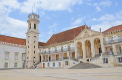 University Campus in portuguese Coimbra. Beautiful tower and nearby courtyard in the campus of the University of Coimbra, Portugal. It is the oldest university stock photography
