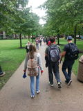 University Campus: Students Walking Between Class. Marshall University is a public college in Huntington West Virginia. The school is over 175 years old.  A Royalty Free Stock Image