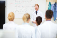 University chemistry professor studying his students Royalty Free Stock Photo