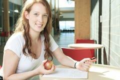 University / college student girl looking happy Stock Image