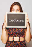 University college student holding a chalkboard saying lecture Royalty Free Stock Photography