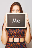 University college student holding a chalkboard saying Me Royalty Free Stock Photography
