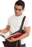 University college student reading. University or college male student reading or studying a text book.   White background Royalty Free Stock Image