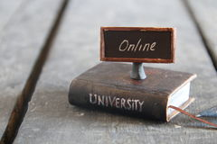 University courses online idea. Book - computer and inscription university, vintage style Royalty Free Stock Image