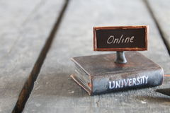 University courses online idea. Book - computer and inscription university, vintage style Royalty Free Stock Photography