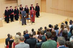 University Dean and board of officials giving speech at final diploma graduation ceremony Stock Photo