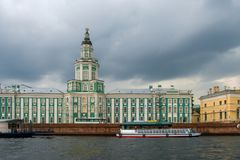 University Embankment house 3 with the building of the Cabinet of curiosities. RUSSIA, SAINT PETERSBURG - AUGUST 18, 2017: University Embankment house 3 with Royalty Free Stock Photo