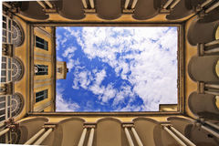 University of Genoa italy, yard and sky. Blue sky and clouds from the internal yard of the University of Genoa central building, a beautiful specimen of old stock images