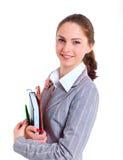 University girl holding books. Portrait of university girl holding books and smiling. Isolated over white background Stock Photography