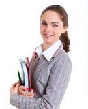 University girl holding books. Portrait of university girl holding books and smiling. Isolated over white background Royalty Free Stock Images
